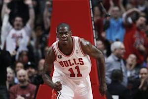 Chicago Bulls Ronnie Brewer celebrates a dunk on the Dallas Mavericks in Chicago