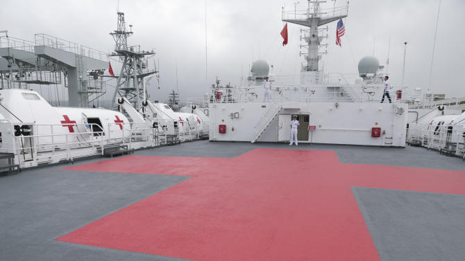 CORRECTS SPELLING OF HICKAM, NOT HICKHAM - A red cross marks the deck aboard the Chinese People's Liberation Army Navy hospital ship Peace Ark, Saturday, July 5, 2014, at Hawaii's Joint Base Pearl Harbor-Hickam. Rim of the Pacific (RIMPAC) multinational naval exercises will be taking place in and around the Hawaiian Islands. (AP Photo/Marco Garcia)