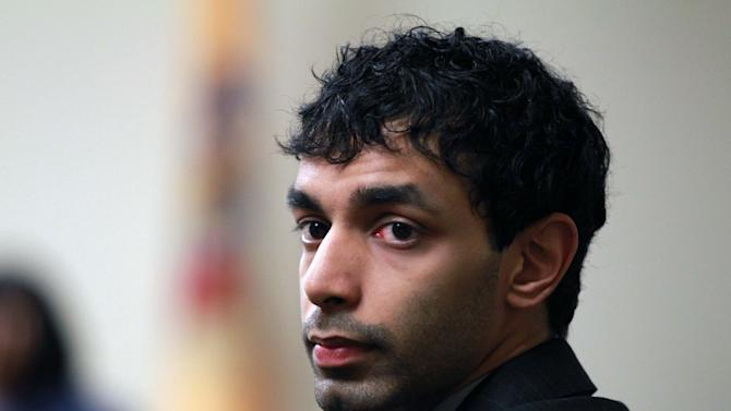 FILE-- In a March 9, 2012 file photo, Dharun Ravi, the former Rutgers University student who was found guilty of hate crimes for using a webcam to view his roommate at Rutgers University kissing another man, waits before court proceedings in New Brunswick, N.J. In a legal filing Tuesday, May 1, 2012, Ravi's lawyers asked a judge to overturn the jury's conviction. They said the jury convicted Ravi in March despite evidence that he was not guilty of invading the privacy or intimidating roommate Tyler Clementi, who killed himself days after the webcam was used. (AP Photo/The Star-Ledger, John Munson, Pool, File)