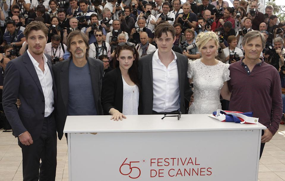 From left actor Garret Hedlund, director Walter Salles, actors Kristen Stewart, Sam Riley, Kirsten Dunst and Viggo Mortensen pose during a photo call for On the Road at the 65th international film festival, in Cannes, southern France, Wednesday, May 23, 2012. (AP Photo/Lionel Cironneau)