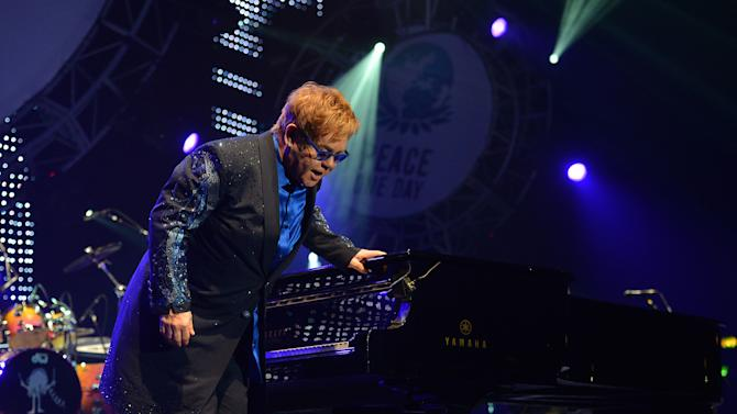 Sir Elton John performs at Peace One Day at Wembley Arena on Friday Sept 21, 2012, in London. (Photo by Mark Allan/AP Images)