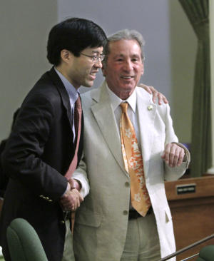 Assemblyman Tom Ammiano, D-San Francisco, right, receives congratulations from Assemblyman Richard Pan. D-Sacramento, after the measure he was carrying requiring public schools to teach the historical contributions of gay Americans, was approved by the Assembly in Sacramento, Calif., Tuesday, July 5, 2011.  The bill, which had passed the Senate, was approved 49-25 on a party line vote and sent to the Governor.(AP Photo/Rich Pedroncelli)