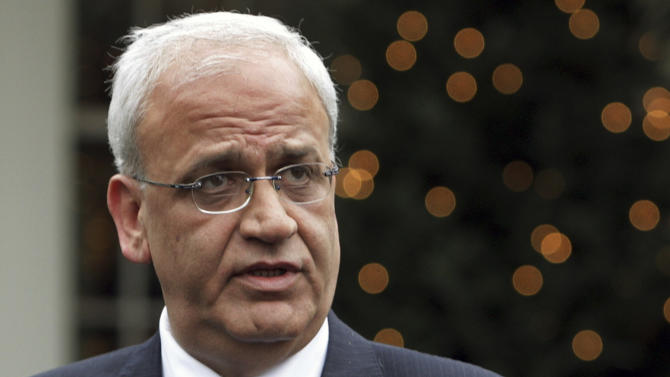 FILE - In this Nov. 26, 2007 file photo, Palestinian chief negotiator Saeb Erekat speaks with reporters outside the White House in Washington. Erekat said Thursday, Sept. 19, 2013, that Israel's claims to the West Bank's Jordan Valley are driven by economic interests, not security and that Israeli farming settlements in the valley earned more than $600 million last year. (AP Photo/Ron Edmonds, File)