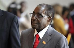 Zimbabwe's President Mugabe arrives for a meeting in Addis Ababa
