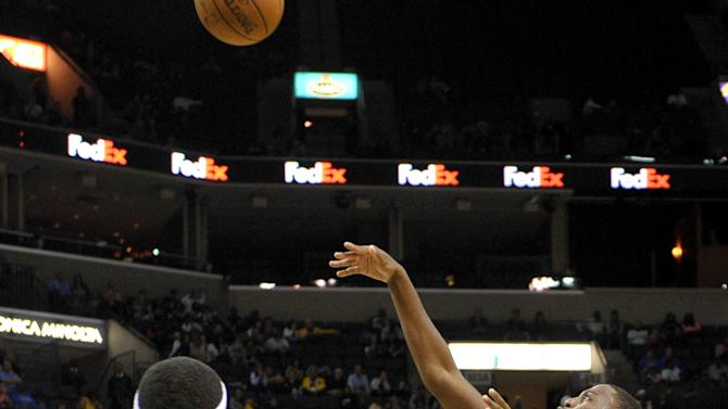 Memphis Grizzlies guard Jordan Adams (3) draws a foul on a fadeaway shot, making it a three-point play, after the free throw in the second half of a preseason NBA basketball game against the Miami Heat, Friday, Oct. 24, 2014, in Memphis, Tenn. (AP Photo/Brandon Dill)