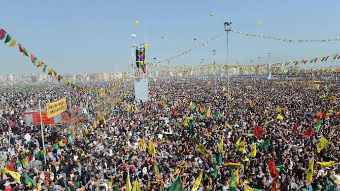 Some thousands of supporters demonstrate waving various PKK flags and posters of jailed Kurdish rebel leader Abdullah Ocalan, in southeastern Turkish city of Diyarbakir, Turkey, Thursday, March 21, 2013, as Ocalan called Thursday for an immediate cease-fire and for thousands of his fighters to withdraw from Turkish territory, a major step toward ending the fighting for self-rule for Kurds in southeastern Turkey, one of the world's bloodiest insurgencies lasting nearly 30-years and costing tens of thousands of lives. (AP Photo)
