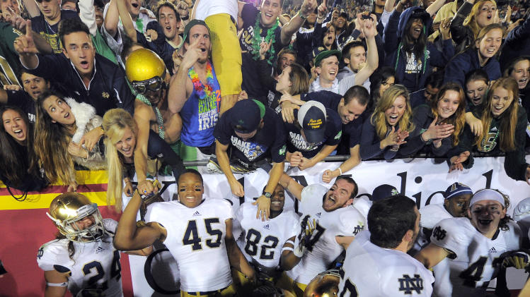 Notre Dame team members celebrate after defeating Southern California 22-13 in an NCAA college football game, Saturday, Nov. 24, 2012, in Los Angeles. (AP Photo/Mark J. Terrill)