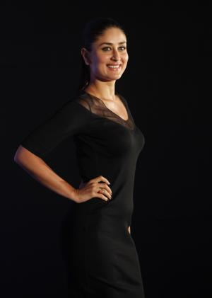 FILE- In this June 6, 2012 file photo, Bollywood actress Kareena Kapoor poses for the media during a promotional event in Mumbai, India. Kapoor said the portrayal of women in Indian cinema is changing and increasingly film directors are creating more meaningful roles for them. (AP Photo/Rafiq Maqbool, File)
