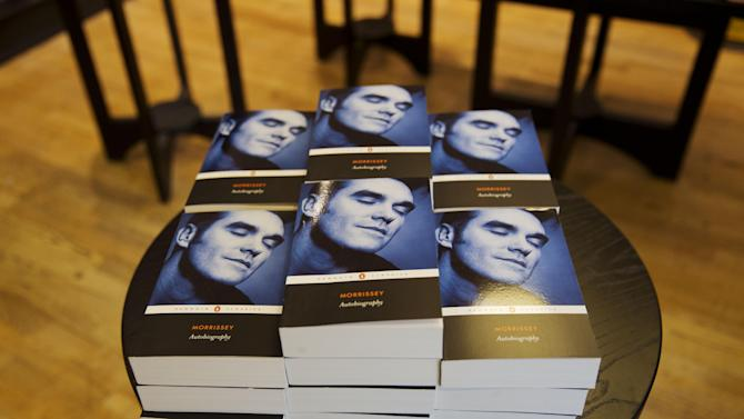 "Copies of the Morrissey ""Autobiography"" lie stacked up on display at a branch of a bookstore in north London, Friday, Oct. 18, 2013. The memoir from the former frontman of The Smiths _ titled simply ""Autobiography"" _ is the first rock bio published under the venerable Penguin Classics imprint, home to Aeschylus, Jane Austen and Oscar Wilde. That has horrified some people in the publishing industry, but not the singer's many fans, who snapped up the book as soon as it was published Thursday. (AP Photo/Matt Dunham)"