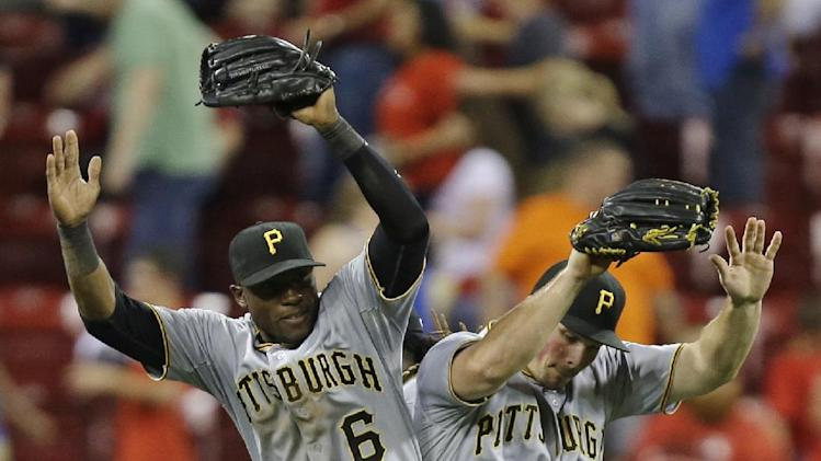 Pirates end Latos' streak, beat Reds 4-0