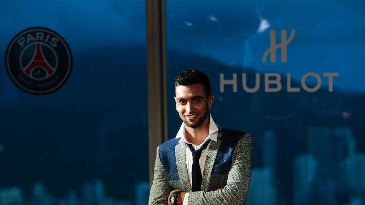 Paris Saint-Germain soccer player Pastore poses at a fashion show in Hong Kong