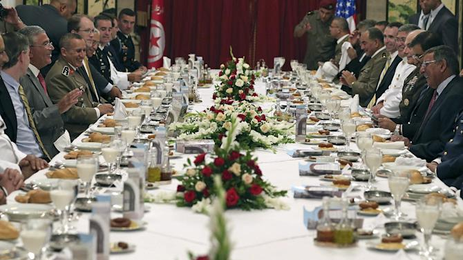 Secretary of Defense Leon Panetta, right, and his delegation attend a dinner with Tunisian Minister of Defense Abdelkrim Zbidi at the Belvedere Officers Club Monday, July 30, 2012 in Tunis, Tunisia. (AP Photo/Mark Wilson, Pool)