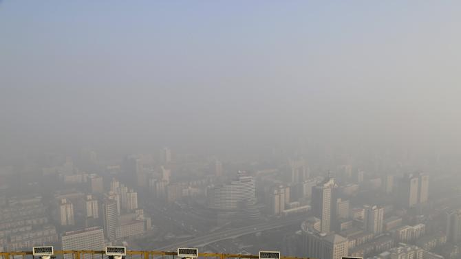 A view from a viewing deck on the China Central Radio and Television Tower shows the city of Beijing in heavy smog