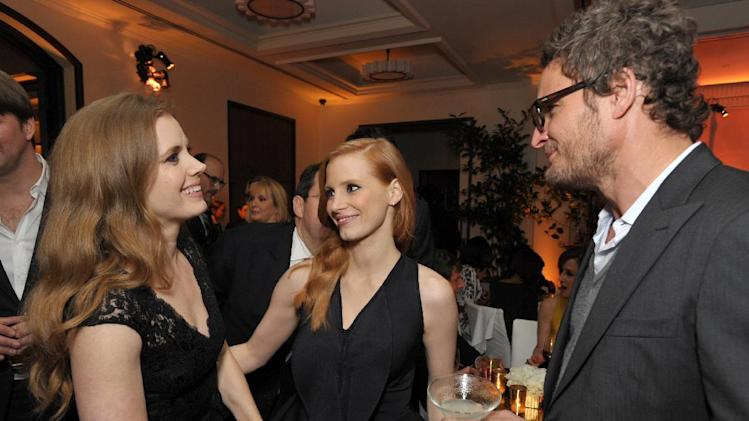 From left, Amy Adams, Jessica Chastain and Jason Clarke attend The Hollywood Reporter Nominees' Night at Spago on Monday, Feb. 4, 2013, in Beverly Hills, Calif. (Photo by John Shearer/Invision for The Hollywood Reporter/AP Images)