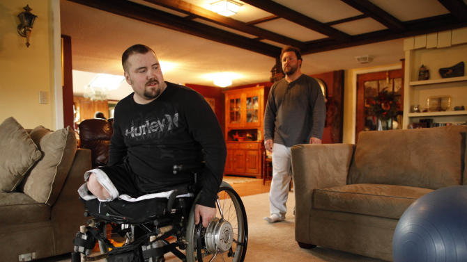 In this April 8, 2011 photo, Sgt. James Hackemer, does does physical therapy with the help of friend Matt Mescall in Gowanda, N.Y. Hackemer, a U.S. Army veteran who lost his legs while deployed in Iraq was thrown from a 200-foot-tall roller coaster at an upstate theme park on Friday, July 8, 2011 and was killed.  Hackemer, 29, was ejected from the Ride of Steel roller coaster at the Darien Lake Theme Park Resort, located between Buffalo and Rochester, at about 5:30 p.m., the Genesee County sheriff's office said.   (AP Photo/Buffalo News,  Derek Gee)