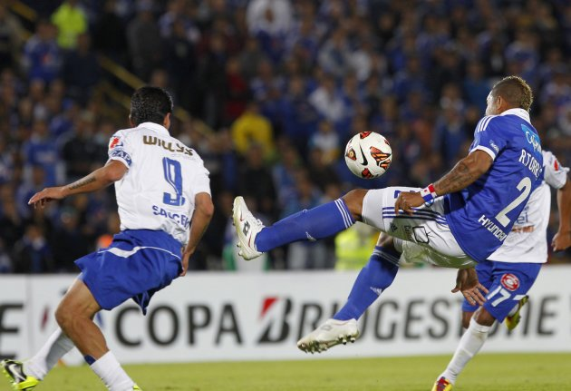 Torres of Colombia's Millonarios and Saucedo of Bolivia's San Jose compete for the ball during their Copa Libertadores soccer match in Bogota