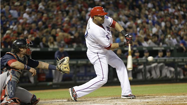 Texas Rangers Nelson Cruz (17) hits an RBI single in front of Boston Red Sox catcher Jarrod Saltalamacchia during the fourth inning of a baseball game Friday, May 3, 2013, in Arlington, Texas. Adrian Beltre scored. (AP Photo/LM Otero)