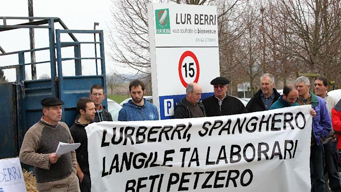 "French farmers hold a placard reading ""Lurberri, Spanghero, peasants and workers always cuckolds"" as they demonstrate in support of the cooperative Lur Berri group, which includes Spanghero society, which is identified by French Consumer Affairs Minister Benoit Hamon as a major culprit in the use of horse meat in food products, in Aicirits,  southwestern France, Monday, Feb. 18, 2013.  Tests have found horsemeat in school meals, hospital food and restaurant dishes in Britain, as the scandal over adulterated meat spread beyond frozen supermarket products, and Britain's Environment Secretary Owen Paterson called for a Europe-wide overhaul of food testing in the wake of the ongoing horsemeat scandal.  The Spanghero company denied wrongdoing.(AP Photo/Bob Edme)"