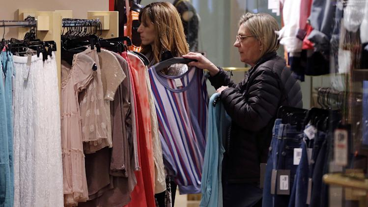 In this March 5, 2013 photo, shoppers look at clothing on sale at the Footloose store in Mt. Lebanon, Pa. The Conference Board, a New York-based private research group, said its reading of consumer confidence fell in March after rebounding last month. The index gauges how Americans are feeling about their jobs, incomes and other bread-and-butter issues. That's important because consumer spending accounts for 70 percent of U.S. economic activity. (AP Photo/Gene J. Puskar)