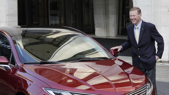 Ford Motor Co. President and CEO Alan Mulally laughs while standing next to a Lincoln MKZ during a press conference, Monday, Dec. 3, 2012 in New York. The MKZ will arrive at dealerships this month. The MKZ is the first of seven new or revamped Lincolns that will go on sale by 2015. (AP Photo/Mark Lennihan)
