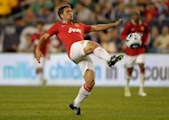Former England striker Michael Owen, seen here playing for Manchester United in July, believes he can find a new club before the transfer window shuts. He has been released after three years at Old Trafford