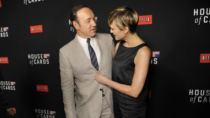 "Kevin Spacey, left, and Robin Wright arrive at a special screening for season 2 of ""House of Cards"", on Thursday, Feb. 13, 2014 in Los Angeles. (Photo by Chris Pizzello/Invision/AP)"