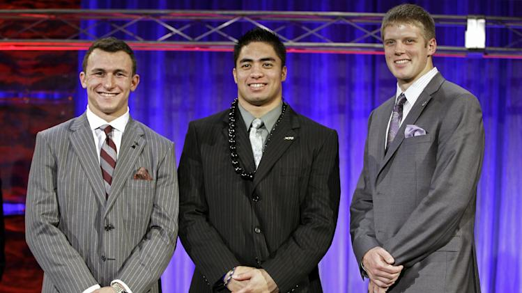 FILE - In this Thursday, Dec. 6, 2012 file photo, from left, Heisman Trophy candidates: Texas A&M's Johnny Manziel; Notre Dame's Manti Te'o and Kansas State's Collin Klein pose for a photo at the Home Depot College Football Awards in Lake Buena Vista, Fla. The Heisman Trophy will be awarded Saturday, Dec. 8, 2012, in New York. (AP Photo/John Raoux, File)