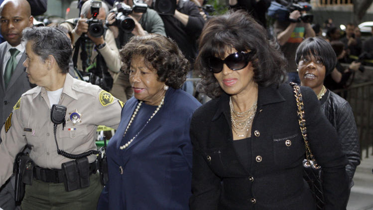 Michael Jackson's mother Katherine Jackson, left, and sister Rebbie arrive for the sentencing of Conrad Murray, convicted of involuntary manslaughter in the death of pop star Michael Jackson, at the Los Angeles Criminal Justice Center, Tuesday, Nov. 29, 2011. (AP Photo/Reed Saxon)