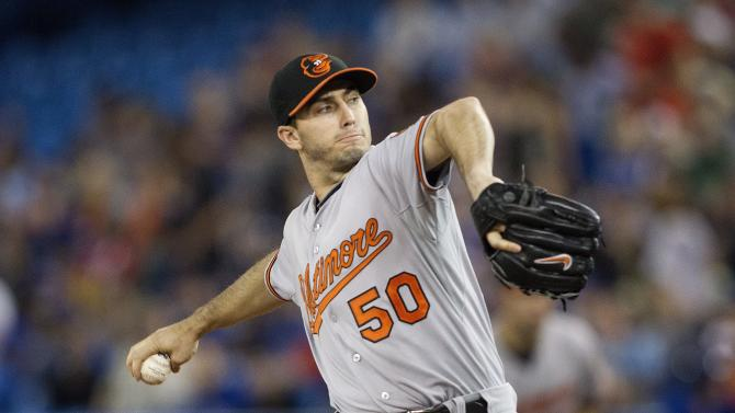 Baltimore Orioles starting pitcher Miguel Gonzalez works against Toronto Blue Jays during the first inning of a baseball game in Toronto, Saturday, June 22, 2013. (AP Photo/The Canadian Press, Chris Young)
