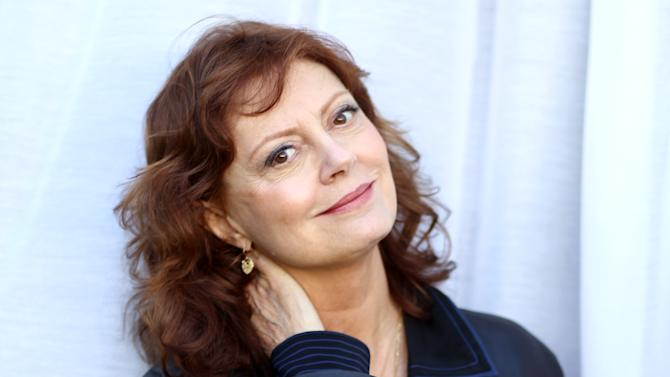 "In this Oct. 14, 2012 photo, actress Susan Sarandon, from the upcoming film ""Cloud Atlas,"" poses for a portrait in Beverly Hills, Calif. The stars of ""Cloud Atlas,"" along with British author David Mitchell, who wrote the novel that inspired the genre-bending epic about souls returning and intertwining over the centuries, shared their beliefs and disbeliefs about reincarnation as the film heads to U.S. theaters Oct. 26, 2012. Hanks himself doesn't buy into reincarnation, while Berry, Whishaw, Mitchell, Sarandon and co-stars Hugo Weaving and Jim Sturgess either believe or at least think it's possible that souls come back for an encore. (Photo by Matt Sayles/Invision/AP)"