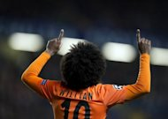 Shakhtar Donetsk&#39;s Brazilian player Willian celebrates after scoring against Chelsea in the UEFA Champions League at Stamford Bridge on November 7, 2012. Shakhtar won the last edition of the UEFA Cup in 2009 but the club is now enjoying what could be its best ever season -- outclassing rivals Dynamo Kiev to head the Ukrainian domestic league and into the last 16 of the Champions League