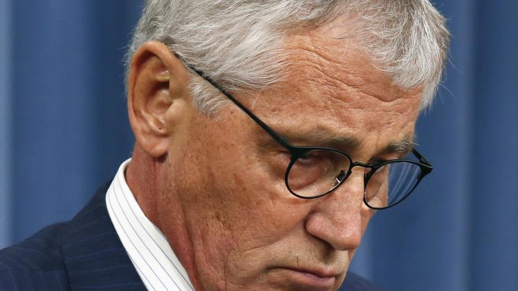 U.S. Secretary of Defense Chuck Hagel pauses during a media briefing at the Pentagon in Washington