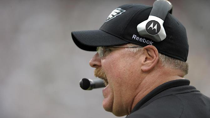 FILE - This Sept. 25, 2011 file photo shows Philadelphia Eagles coach Andy Reid calling out plays in the second half of an NFL football game against the New York Giants in Philadelphia. Reid and the Kansas City Chiefs should be quite familiar by now. The two sides spent much of Thursday, Jan. 3, 2013 in negotiations for Reid to become the Chiefs' coach, a person familiar with the situation told The Associated Press. The person spoke to the AP on condition of anonymity because he wasn't authorized to discuss the situation. (AP Photo/Michael Perez, File)