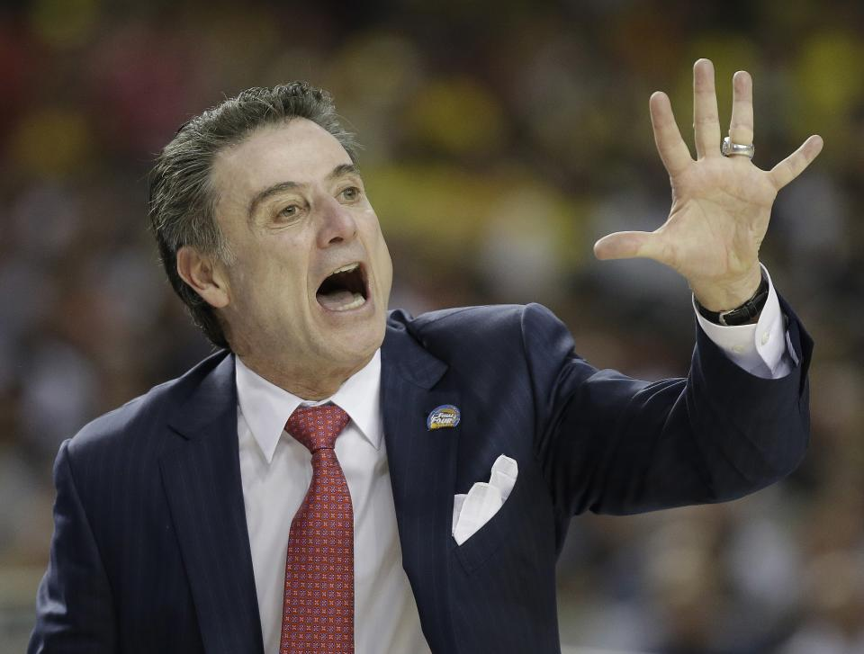 Louisville head coach Rick Pitino calls a play against Wichita State during the first half of the NCAA Final Four tournament college basketball semifinal game Saturday, April 6, 2013, in Atlanta. (AP Photo/David J. Phillip)