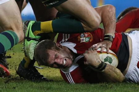 British and Irish Lions' Croft is tackled during their rugby union test match against the Wallabies at Suncorp Stadium in Brisbane