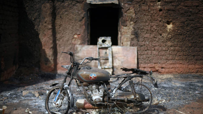 In this image taken during an official visit organized by the Malian army to the town of Konna, some 680 kilometers (430 miles) north of Mali's capital Bamako, Saturday, Jan. 26, 2013, a motorcycle stands charred. One wing of Mali's Ansar Dine rebel group has split off to create its own movement, saying that they want to negotiate a solution to the crisis in Mali, in a declaration that indicates at least some of the members of the al-Qaida linked group are searching for a way out of the extremist movement in the wake of French air strikes. (AP Photo/Jerome Delay)