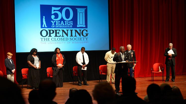 In this photo provided by the University of Mississippi, Reverend Leroy Wadlington gives the closing blessings to the audience assembled at the University of Mississippi's Gertrude Ford Center for the Performing Arts to recognize Ole Miss's 50th anniversary of integration in Oxford, Miss., on Sunday evening, Sept. 30, 2012. The planned Walk of Reconciliation and Redemption and candlelight vigil were moved to the Ford Center due to rain. (AP Photo/University of Mississippi, Robert Jordan)
