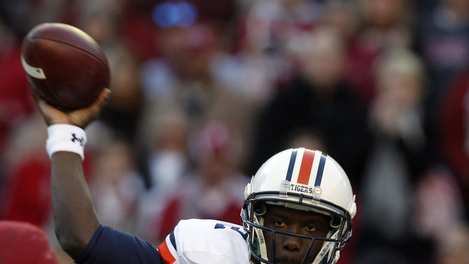Auburn quarterback Jonathan Wallace (12) throws a screen pass during the first half of an NCAA college football game against Alabama on Saturday, Nov. 24, 2012, in Tuscaloosa, Ala. (AP Photo/Butch Dill)