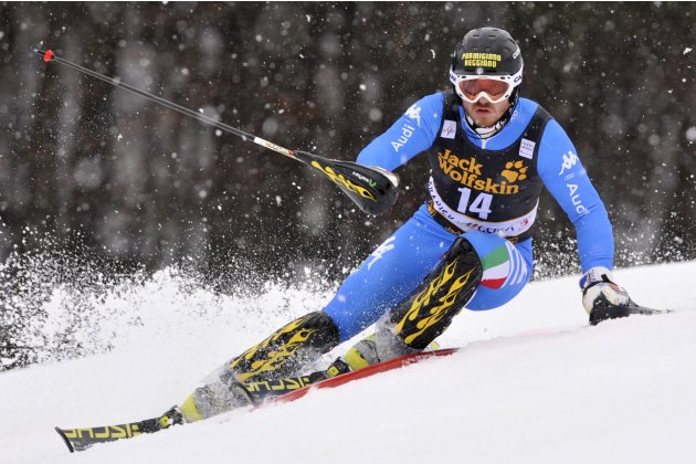 Giuliano Razzoli of Italy clears a gate during his first run of the men's Slalom event at the Alpine Skiing World Cup in Kranjska Gora