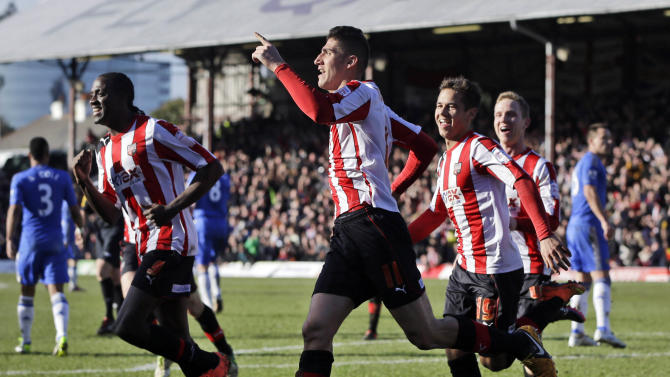 Brentford's Marcello Trotta celebrates after scoring against Chelsea, during their English FA Cup fourth round soccer match in London, Sunday, Jan. 27, 2013. The match ended 2-2 draw. (AP Photo/Lefteris Pitarakis)