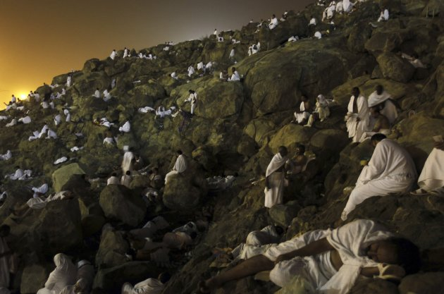Muslim pilgrims sit on Mount …