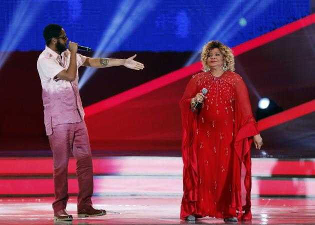 Brazilian singers Alcione and Emicida perform during the draw for the 2014 World Cup at the Costa do Sauipe resort in Sao Joao da Mata