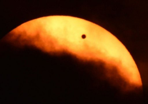 <p>Clouds partially obscure the sun during the transit of Venus as seen from Riverside Park on the west side of Manhattan in New York. Astronomers around the world trained their telescopes on the skies Tuesday to watch Venus pass in front of the Sun, a once-in-a-lifetime event that will not be seen for another 105 years.</p>