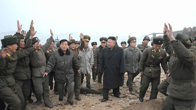 In this March 7, 2013 photo released by the Korean Central News Agency (KCNA) and distributed March 8, 2013 by the Korea News Service, North Korean leader Kim Jong Un, center, is welcomed by military personnel at a military unit on Jangjae islet, located in the southernmost part of the southwestern sector of North Korea's border with South Korea.  Seven years of U.N. sanctions against North Korea have done nothing to derail Pyongyang's drive for a nuclear weapon capable of hitting the United States. They may have even bolstered the Kim family by giving their propaganda maestros ammunition to whip up anti-U.S. sentiment and direct attention away from government failures.   (AP Photo/KCNA via KNS) JAPAN OUT UNTIL 14 DAYS AFTER THE DAY OF TRANSMISSION