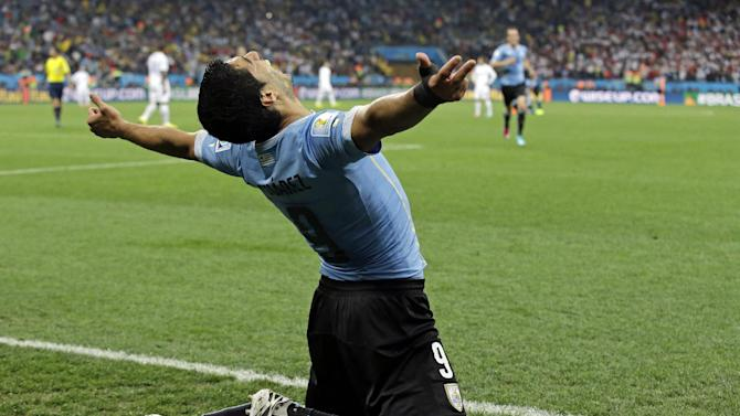 Uruguay's Luis Suarez celebrates after scoring his side's second goal during the group D World Cup soccer match between Uruguay and England at the Itaquerao Stadium in Sao Paulo, Brazil, Thursday, June 19, 2014. (AP Photo/Matt Dunham)