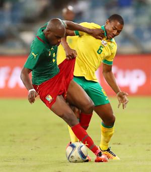 South Africa's Prince Nxumalo (R) tackles Cameroons's …