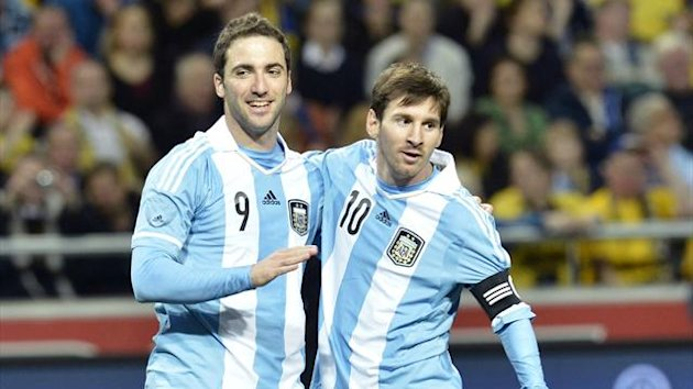 Argentina's Gonzalo Higuain (L) is congratulated by team mate Lionel Messi after a goal during an international friendly match against Sweden at Friends Arena in Stockholm, February 6, 2013 (Reuters)