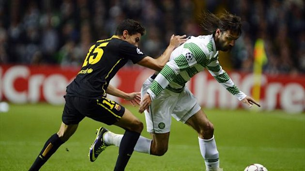 Celtic's Giorgios Samaras (R) challenges Barcelona's Marc Bartra during their Champions League soccer match at Celtic Park in Glasgow, October 1, 2013 (Reuters)