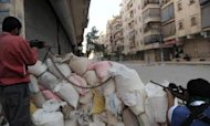 Syrian Envoys Defect As Fighting Continues