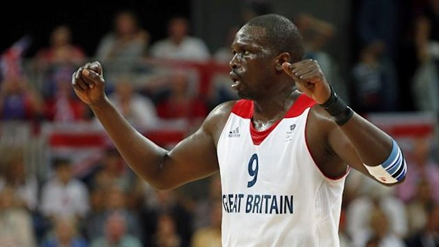 Great Britain's Luol Deng celebrates a basket against Australia during their men's preliminary round Group B match (Reuters)